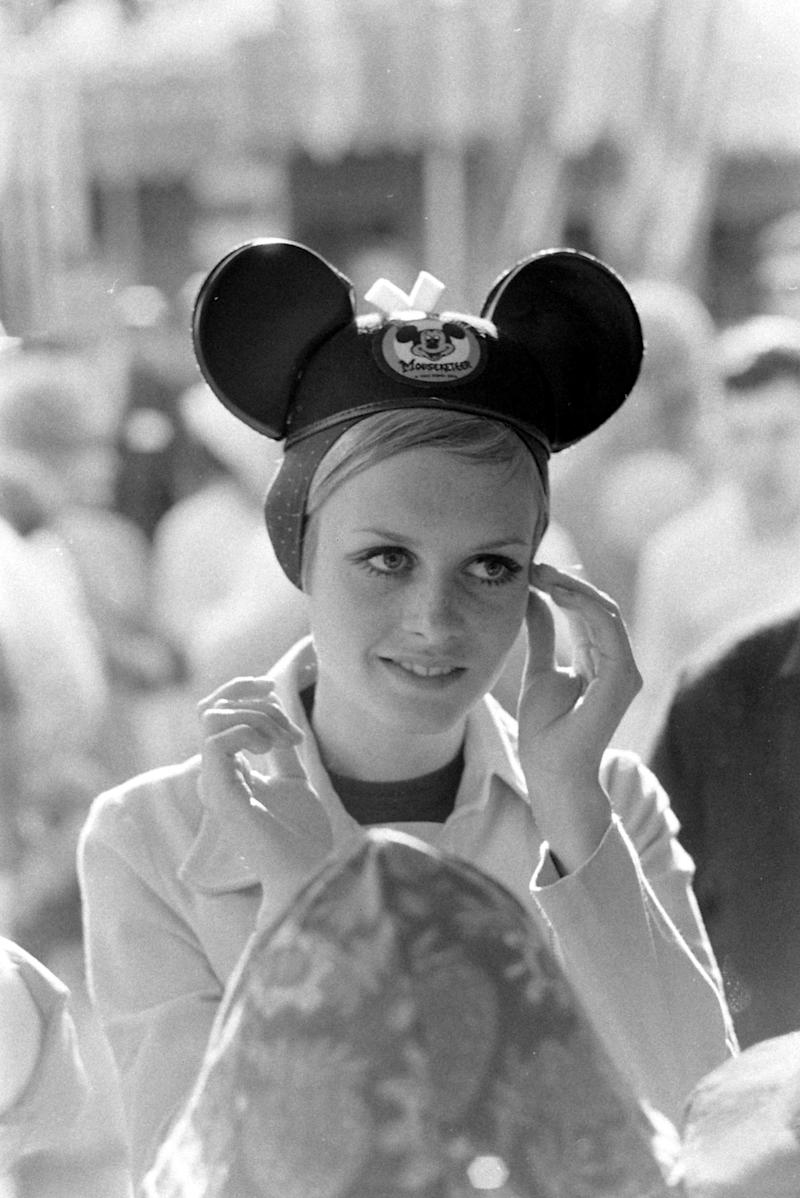 Model Twiggy wears mouse ears during a visit toDisneyland in 1967.