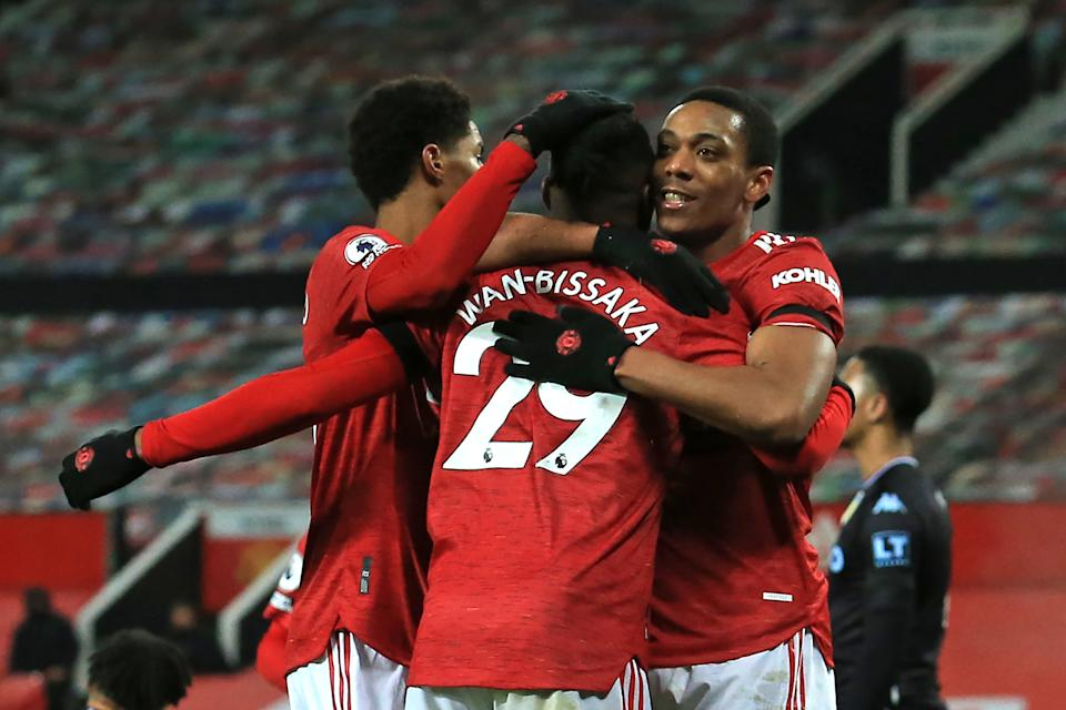 Manchester United striker Anthony Martial (right) celebrates with teammates after scoring the opening goal against Aston Villa.