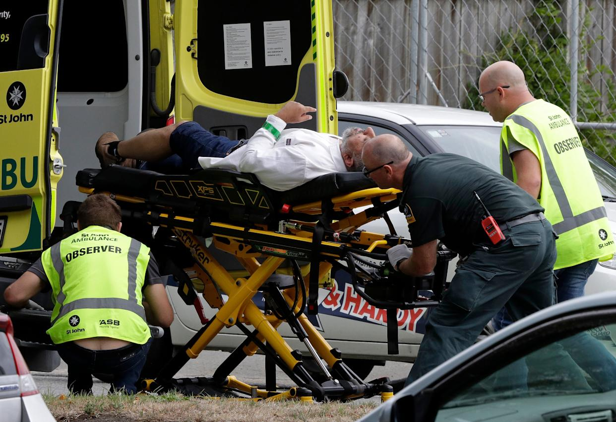 Ambulance staff take a man from outside a mosque in central Christchurch, New Zealand, on March 15, 2019.