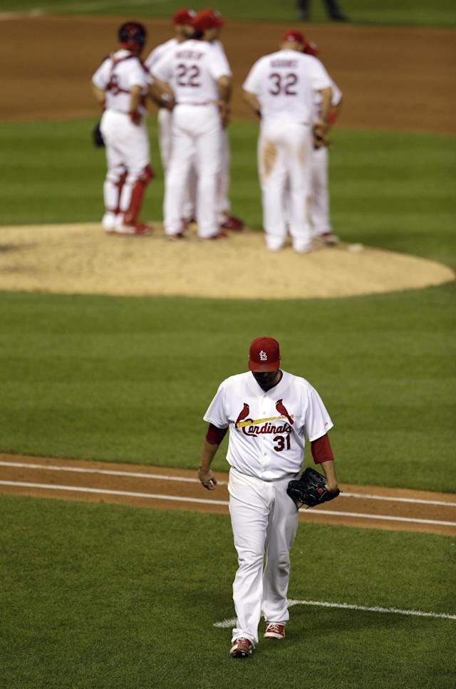 St. Louis Cardinals starting pitcher Lance Lynn, bottom, walks off the field after being removed from a baseball game during the seventh inning against the Tampa Bay Rays, Wednesday, July 23, 2014, in St. Louis. (AP Photo/Jeff Roberson)
