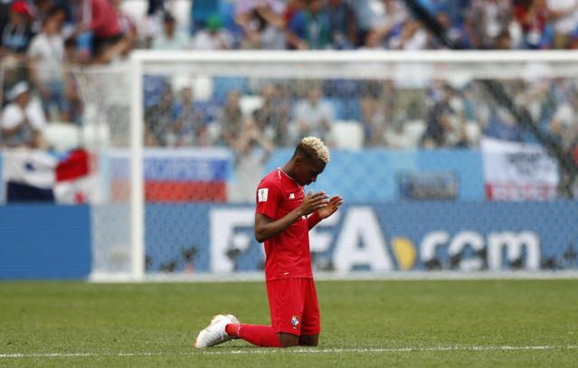 Panama's Michael Murillo kneels on the pitch following his team's 6-1 loss to England in their group G match at the 2018 soccer World Cup at the Nizhny Novgorod Stadium in Nizhny Novgorod , Russia, Sunday, June 24, 2018. (AP Photo/Matthias Schrader)