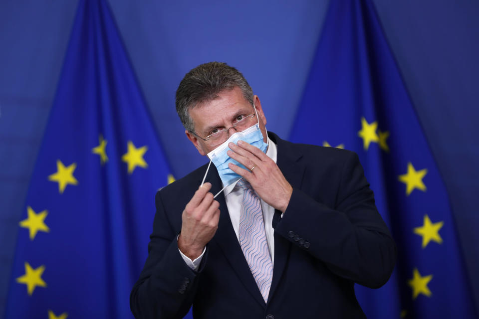 European Commissioner for Inter-institutional Relations and Foresight Maros Sefcovic removes his face mask as he gives a statement on European battery alliance at the European Commission headquarters in Brussels,Tuesday, Jan. 26. 2021. The European Union has approved €2.9 billion (US3.53 billion) in subsidies from 12 member countries for a second pan-European project to develop the bloc's electric battery industry and move away from its reliance on Asian imports. (AP Photo/Francisco Seco, Pool)