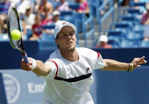 Andreas Seppi, from Italy, returns a serve during a match against Novak Djokovic, from Serbia, at the Western & Southern Open tennis tournament, Wednesday, Aug. 15, 2012, in Mason, Ohio. (AP Photo/Frank Victores)