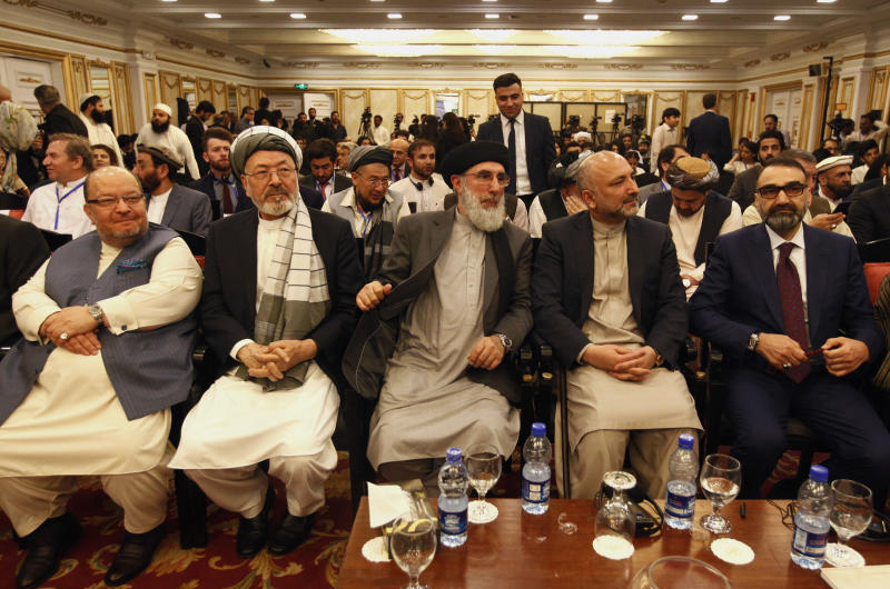 Afghan politicians, from second left to right, Mohammad Karim Khalili, Gulbuddin Hekmatyar, Haneef Atmar and Ustad Atta Mohammad Noor, and others attend the opening session of an Afghan Peace Conference in Bhurban, 65 kilometers (40 miles) north of Islamabad, Pakistan, Saturday, June 22, 2019. Dozens of Afghan political leaders attended a peace conference in neighboring Pakistan on Saturday to pave the way for further Afghan-to-Afghan dialogue. (AP Photo/Anjum Naveed)