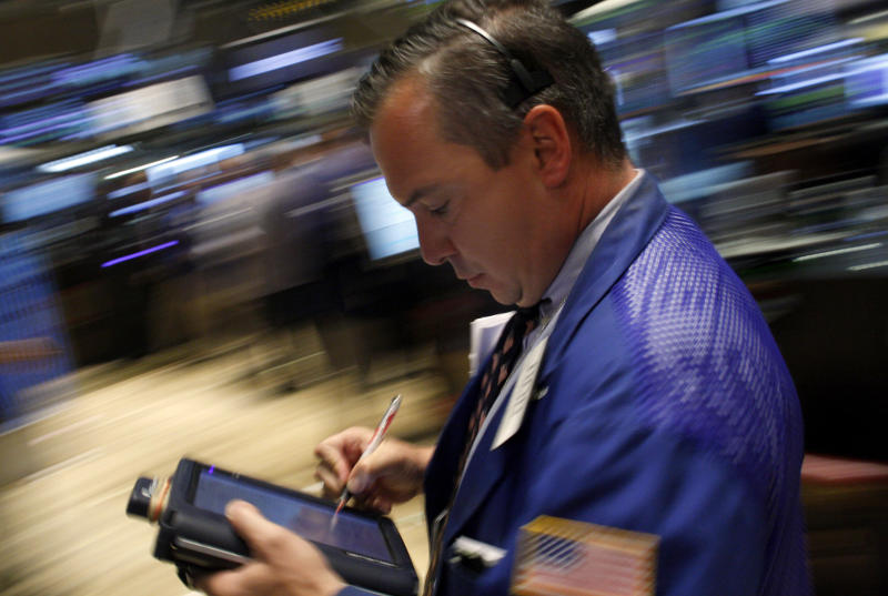 A trader works on the floor of the New York Stock Exchange August 8, 2008. REUTERS/Joshua Lott (UNITED STATES)