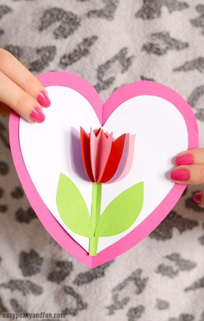 """<p>Any mom will want to hang this adorable pop-up tulip card on the fridge! It's an easy craft for the kids to try.</p><p><strong>Get the tutorial at <a href=""""https://www.easypeasyandfun.com/tulip-in-a-heart-card/"""" rel=""""nofollow noopener"""" target=""""_blank"""" data-ylk=""""slk:Easy Peasy and Fun"""" class=""""link rapid-noclick-resp"""">Easy Peasy and Fun</a>.</strong></p><p><a class=""""link rapid-noclick-resp"""" href=""""https://www.amazon.com/Elmers-All-Purpose-Stick-Single-E515/dp/B000BKTGMW?tag=syn-yahoo-20&ascsubtag=%5Bartid%7C2164.g.35668391%5Bsrc%7Cyahoo-us"""" rel=""""nofollow noopener"""" target=""""_blank"""" data-ylk=""""slk:SHOP GLUE STICKS"""">SHOP GLUE STICKS</a></p>"""