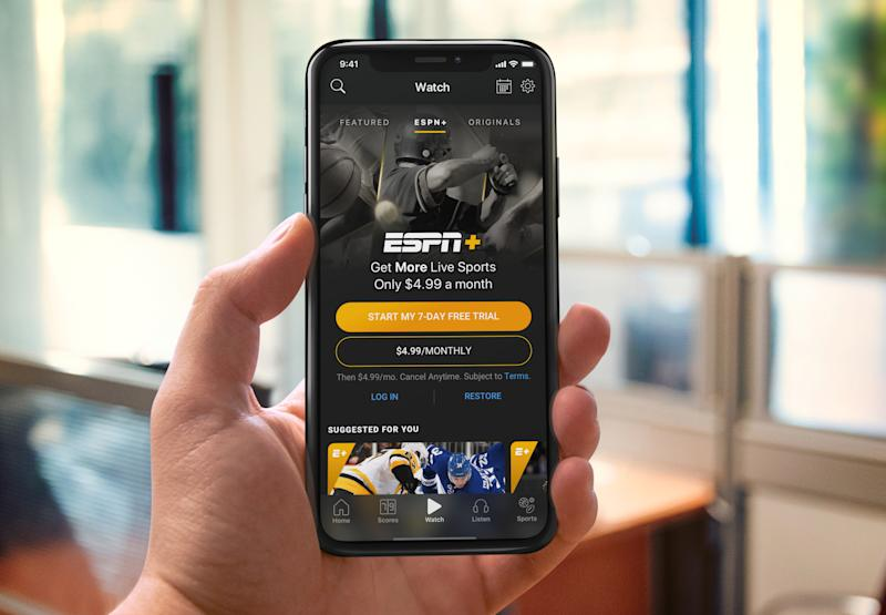 A phone shows ESPN+