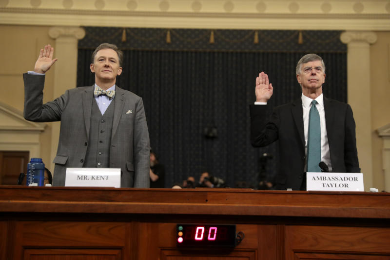 Career foreign service officer George Kent and top U.S. diplomat in Ukraine William Taylor, right, are sworn in to testify during the first public impeachment hearing. (Photo: Andrew Harnik/AP)