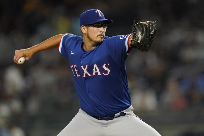 Texas Rangers' Dane Dunning delivers a pitch during the first inning of a baseball game against the New York Yankees Tuesday, Sept. 21, 2021, in New York. (AP Photo/Frank Franklin II)