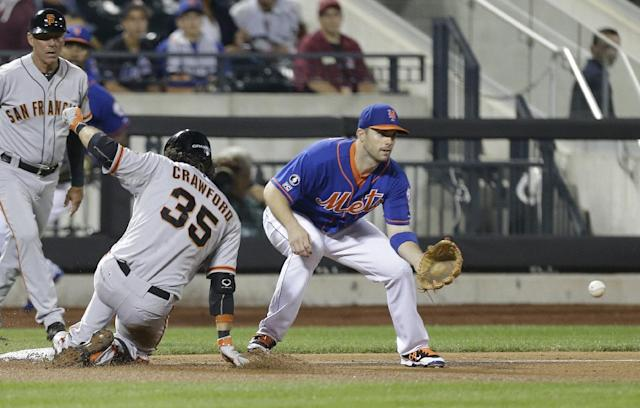 San Francisco Giants' Brandon Crawford (35) slides past New York Mets third baseman David Wright on a triple during the seventh inning of a baseball game Friday, Aug. 1, 2014, in New York. (AP Photo/Frank Franklin II)