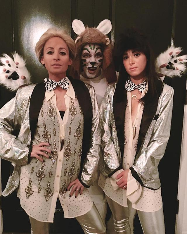 "<p>Richie and a couple of friends channeled legendary animal trainers/illusionists Siegfried and Roy, as well as one of their white tigers — most likely Montecore, who attacked Roy back in 2003. (Photo: <a href=""https://www.instagram.com/p/BMIf0TsgX_S/?taken-by=nicolerichie"" rel=""nofollow noopener"" target=""_blank"" data-ylk=""slk:Instagram"" class=""link rapid-noclick-resp"">Instagram</a>) </p>"