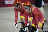 Shanju Bao, right, and Tianshi Zhong of Team China compete during the track cycling women's team sprint finals at the 2020 Summer Olympics, Monday, Aug. 2, 2021, in Izu, Japan. (AP Photo/Christophe Ena)