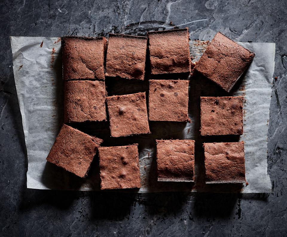 """These brownies moist and fudgy on the inside with a delicate, thin crust on the outside. You may find yourself fighting with your housemates over the crispy-edged corner pieces. <a href=""""https://www.epicurious.com/recipes/food/views/fudgy-brownies?mbid=synd_yahoo_rss"""" rel=""""nofollow noopener"""" target=""""_blank"""" data-ylk=""""slk:See recipe."""" class=""""link rapid-noclick-resp"""">See recipe.</a>"""