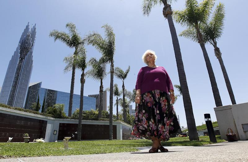 Retired schoolteacher Dolores Rommel looks to her husbands remains in a vault at the Crystal Cathedral cemetery in Garden Grove, Calif., Tuesday, June 19, 2012. Roman Catholic church bought the famous sanctuary and its cemetery in bankruptcy court last year. (AP Photo/Chris Carlson)