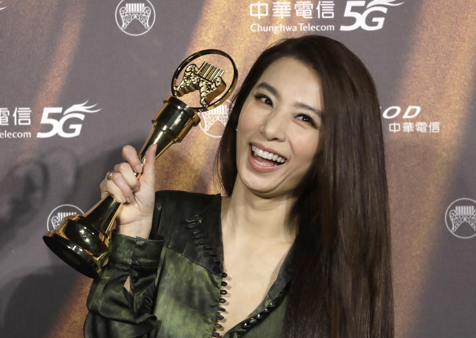 Taiwanese singer Hebe Tien holds her award of Best Female Singer of the 32nd Golden Melody Awards in Taipei, Taiwan, Saturday, Aug. 21, 2021. Golden Melody Awards, one of the world's biggest Chinese-language pop music annual events and postponed from June to Aug. due to the coronavirus pandemic. (AP Photo/Chiang Ying-ying)