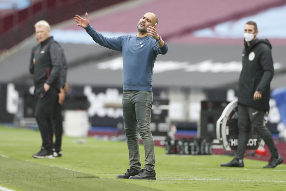 Manchester City's head coach Pep Guardiola reacts during the English Premier League soccer match between West Ham and Manchester City, at the London Olympic Stadium Saturday, Oct. 24, 2020. (Paul Childs, Pool via AP)