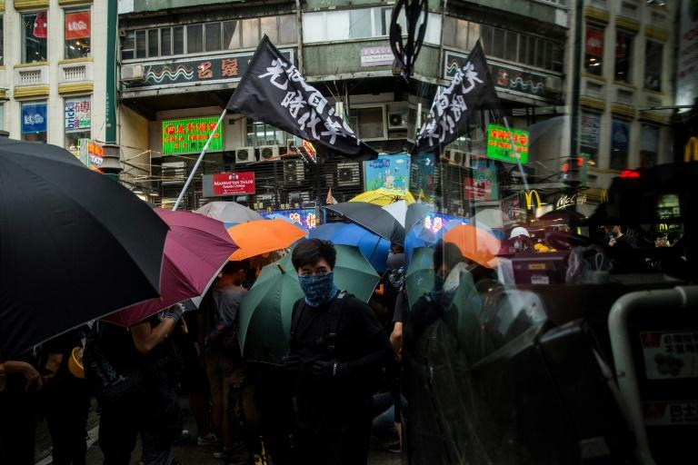 Many roads in the tourist district Tsim Sha Tsui were blocked by protesters (AFP Photo/Isaac Lawrence)