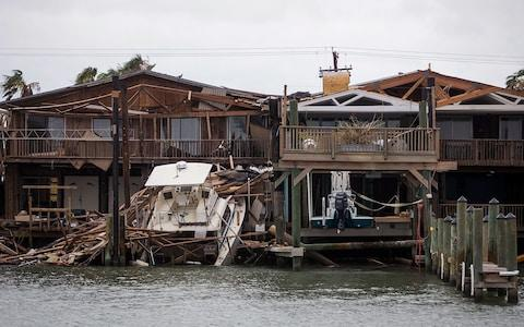 A boat sits on a dock after Hurricane Harvey passed through Port Aransas, Texas - Credit: Nick Wagner