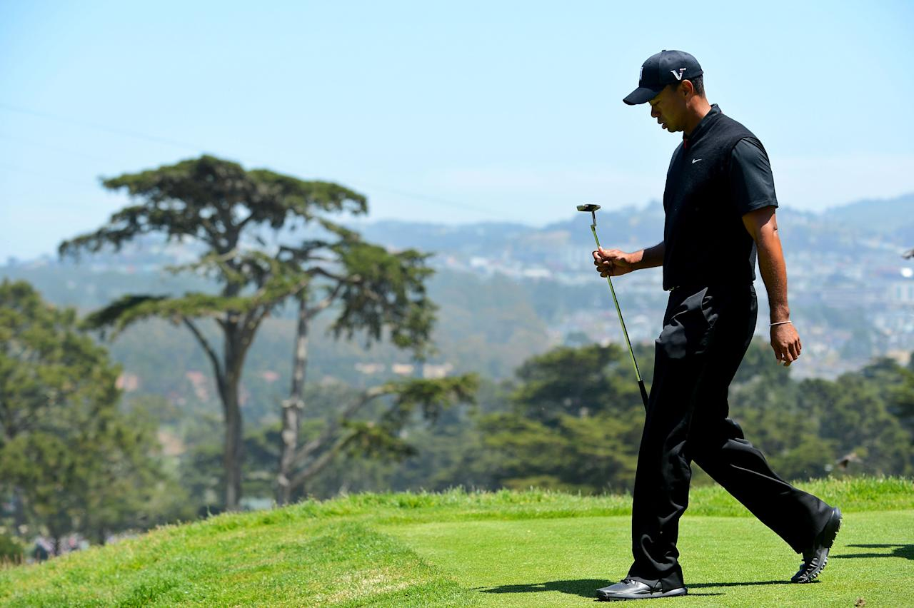 SAN FRANCISCO, CA - JUNE 15:  Tiger Woods of the United States walks off the third tee during the second round of the 112th U.S. Open at The Olympic Club on June 15, 2012 in San Francisco, California.  (Photo by Stuart Franklin/Getty Images)