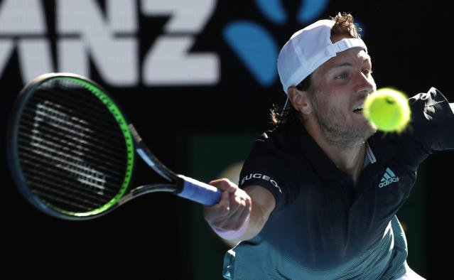 France's Lucas Pouille makes a forehand return to Canada's Milos Raonic during their quarterfinal match at the Australian Open tennis championships in Melbourne, Australia, Wednesday, Jan. 23, 2019. (AP Photo/Aaron Favila)