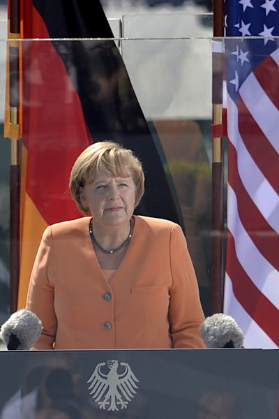 German Chancellor Angela Merkel delivers a speech in front of the Brandenburg Gate in Berlin during a visit of US President, June 19, 2013 (AFP Photo/Odd Andersen)