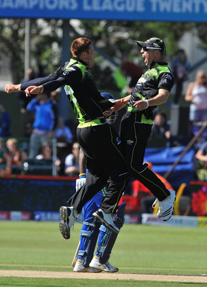 PORT ELIZABETH, SOUTH AFRICA - SEPTEMBER 11: Juan Theron and David Jacobs of the Warriors celebrate the wicket of Mahala Jayawardene of Wayamba for a duck, during the Airtel Champions League Twenty20 match between Chevrolet Warriors and Wayamba Elevens at Axxess DSL St George's on September 11, 2010 in Port Elizabeth, South Africa. (Photo by Duif du Toit/ Gallo Images/Gettry Images)