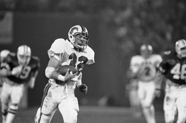 SMU tailback Craig James runs away from BYU defenders during the Holiday Bowl on Dec. 19, 1980. (AP)