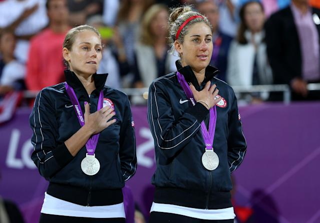 Silver medallists Jennifer Kessy (L) and April Ross of the United States celebrate on the podium during the medal ceremony for the Women's Beach Volleyball on Day 12 of the London 2012 Olympic Games at the Horse Guard's Parade on August 8, 2012 in London, England. (Photo by Cameron Spencer/Getty Images)