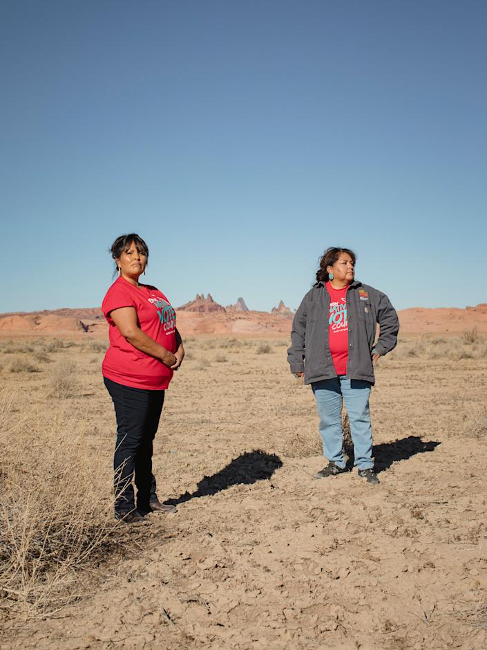 "(L-R) Tara Benally and Dalene Redhorse pose for a portrait in front of Church Rock in Navajo County, Arizona on December 4, 2020. CREDIT: Adria Malcolm for TIME Magazine<span class=""copyright"">Adria Malcolm for TIME Magazine—Adria Malcolm</span>"