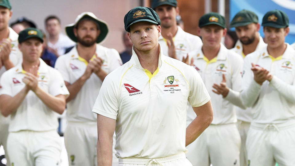 Steve Smith walks up in front of his teammates during the Ashes.
