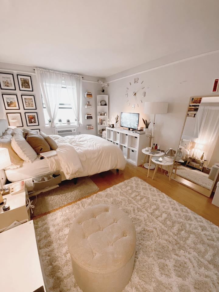 <p>Rugs are an easy way to create a transition from one part of a room to another. This also helps create an illusion of two smaller rooms within one. In my case, one or more rugs help trick the eye into seeing a bigger space and help divide areas in the room.</p>