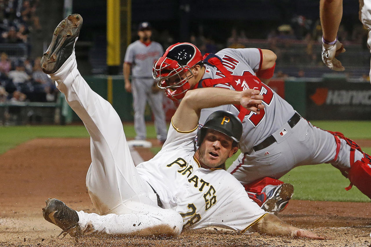 <p>Pittsburgh Pirates' John Jaso (28) slides safely past Washington Nationals catcher Jose Lobaton to score the second of two runs on a single by Andrew McCutchen during the seventh inning of a baseball game in Pittsburgh, May 17, 2017. The Pirates won 6-1. (Photo: Gene J. Puskar/AP) </p>