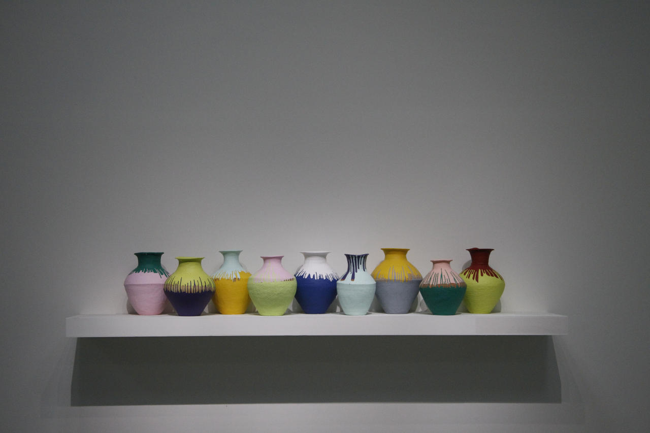 "An instillation entitled ""Colored Vases"" by the Chinese artist and activist Ai Weiwei sits on a shelf at the ""Ai Weiwei is Absent"" exhibition in the Taipei Fine Arts Museum in Taipei, Taiwan, Friday, Oct. 28, 2011. The exhibition opens Oct. 29 and will run for three months. (AP Photo/Wally Santana)"
