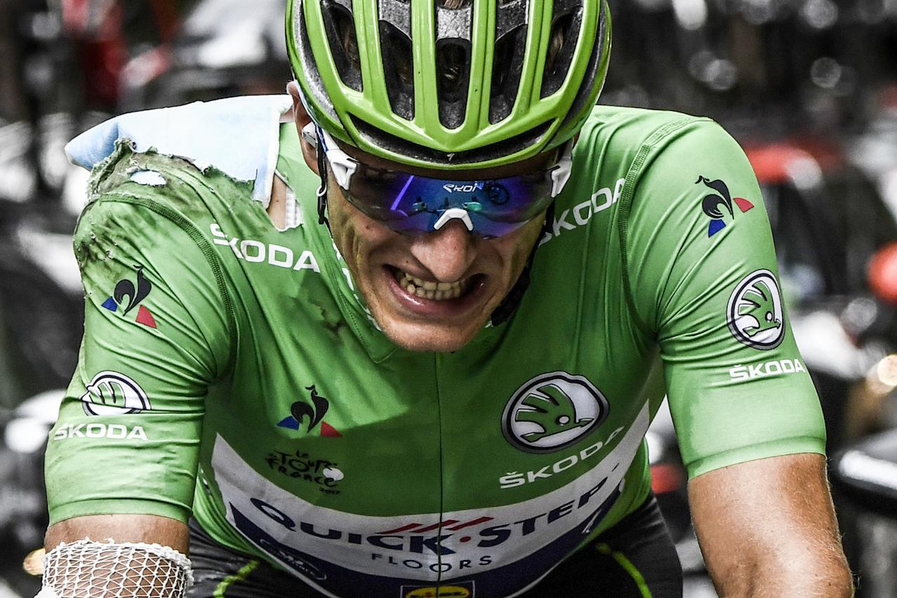 (FILES) This file photo taken on July 19, 2017 shows Germany's Marcel Kittel wearing the best sprinter's green jersey, during the 183 km seventeenth stage of the 104th edition of the Tour de France cycling race between Le La Mure and Serre-Chevalier, French Alps. Sprint star Marcel Kittel has quit Belgium's Team Quick Step-Floors to link up with Germany's world time-trial champion Tony Martin at Swiss outfit Katusha-Alpecin, it was announced on August 16, 2017. (AFP Photo/Jeff PACHOUD)