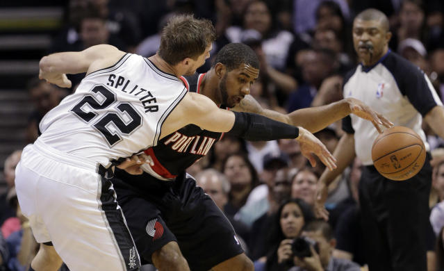 San Antonio Spurs' Tiago Splitter (22), of Brazil, pressures Portland Trail Blazers' LaMarcus Aldridge during the first half of Game 1 of a Western Conference semifinal NBA basketball playoff series, Tuesday, May 6, 2014, in San Antonio. (AP Photo/Eric Gay)