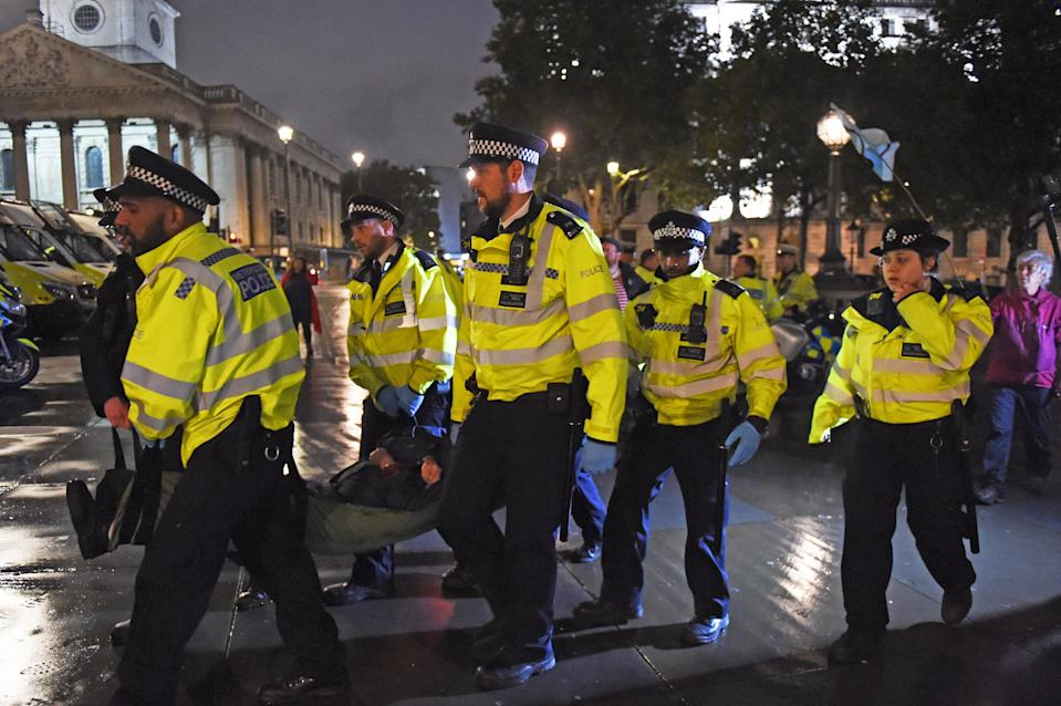 Police remove an Extinction Rebellion protester from Trafalgar Square, central London. (Photo by David Mirzoeff/PA Images via Getty Images)