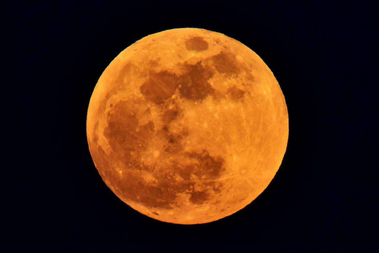 <p>A red supermoon rises over hills in the city of Vladivostok in Russia's Far East on Jan. 31, 2018. (Photo: Yuri Smityuk\TASS via Getty Images) </p>
