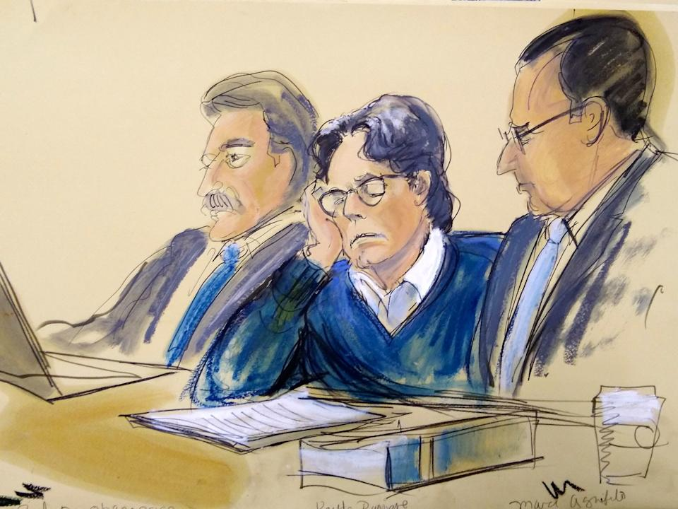 Keith Raniere, center, sits with attorneys Paul DerOhannesian, left, and Marc Agnifilo during closing arguments at Brooklyn federal court, Tuesday, June 18, 2019 in New York.