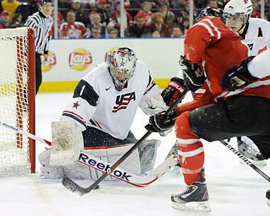 Jack Campbell of Team USA stops the puck on an attempt by Freddie Hamilton of Team Canada 2012 World Junior Hockey Championship in Edmonton