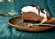 """This chocolate pie recipe has everything you need in order to live: chocolate wafer cookies for crunch, fluffy chocolate mousse filling, and crème fraîche meringue. <a href=""""https://www.bonappetit.com/recipe/mile-high-chocolate-pie?mbid=synd_yahoo_rss"""" rel=""""nofollow noopener"""" target=""""_blank"""" data-ylk=""""slk:See recipe."""" class=""""link rapid-noclick-resp"""">See recipe.</a>"""