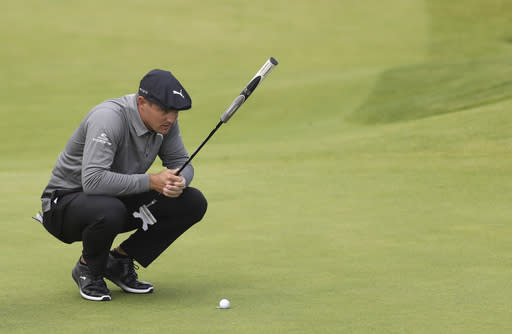 FILE - In this July 18, 2019, file photo, Bryson DeChambeau, of the United States, looks at his putt on the fourth green during the first round of the British Open Golf Championships at Royal Portrush in Northern Ireland. DeChambeau wasted no time defending himself against accusations of slow play Saturday, Aug. 10, after harsh criticism on social media stemming from a video showing him taking more than two minutes to hit an 8-foot putt at The Northern Trust. (AP Photo/Peter Morrison, File)