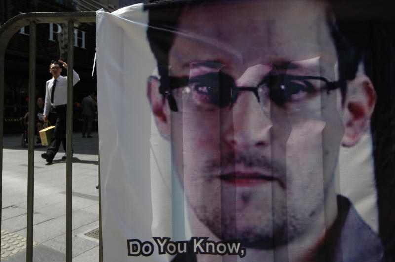 A banner supporting Edward Snowden, a former CIA employee who leaked top-secret documents about sweeping U.S. surveillance programs, is displayed at Central, Hong Kong's business district, Friday, June 21, 2013. U.S. President Barack Obama is holding his first meeting with a privacy and civil liberties board Friday as he seeks to make good on his pledge to have a public discussion about secretive government surveillance programs. (AP Photo/Kin Cheung)