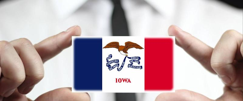 Businessman holding a business card with Iowa State Flag