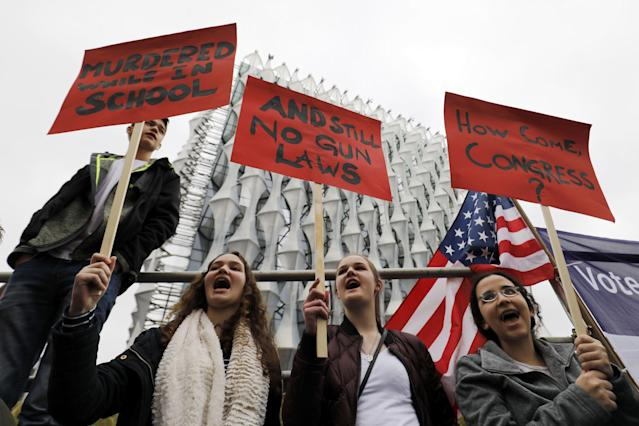<p>Protestors carry placards and shout slogans during a demonstration calling for stricter gun control outside the U.S. Embassy in south London on March 24, 2018. The London rally, in solidarity with the March For Our Lives rallies in the U.S., is one of hundreds of gun control protests taking place globally. (Photo: Tolga Akmen/AFP/Getty Images) </p>