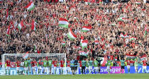 Hungary's players celebrate with their fans after the Euro 2020 soccer championship group F match between Hungary and France at the Ferenc Puskas stadium in Budapest, Hungary Saturday, June 19, 2021. (Tibor Illyes/Pool via AP)