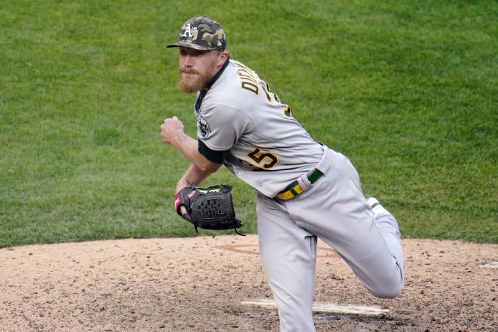 Oakland Athletics' pitcher Jake Diekman throws against the Minnesota Twins in the eighth inning of a baseball game, Saturday, May 15, 2021, in Minneapolis. (AP Photo/Jim Mone)