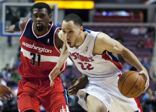 Detroit Pistons' Tayshaun Prince (22) drives to the basket past Washington Wizards' Chris Singleton in the second half of an NBA basketball game, Sunday, Feb. 12, 2012, in Auburn Hills, Mich. The Wizards won 98-77. (AP Photo/Duane Burleson)