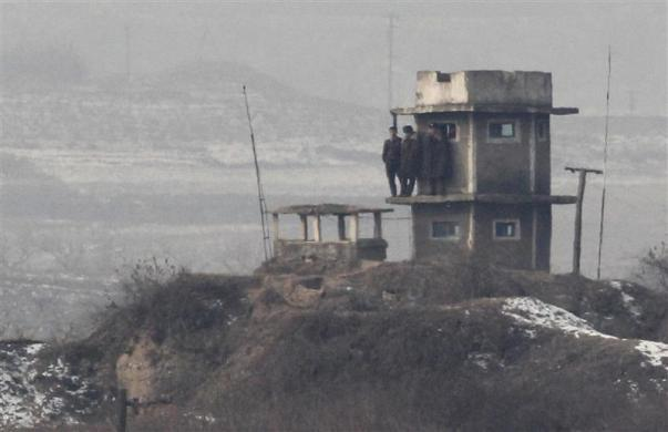 North Korean soldiers stand on their observation post near Panmunjom truce village in the demilitarized zone (DMZ) separating the two Koreas, in Paju, north of Seoul, December 28, 2011.
