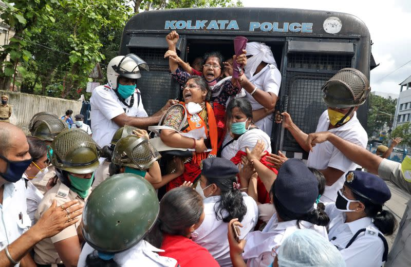 Supporters of India's ruling BJP shout slogans from a police vehicle after being detained by the police during a protest against China, in Kolkata