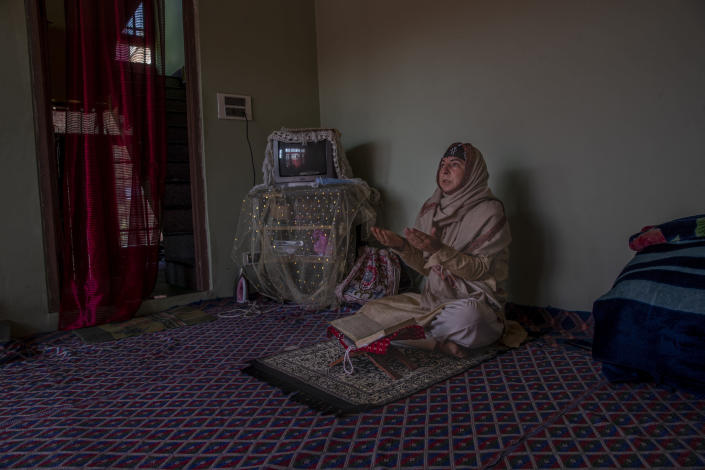 The 35-year-old transgender Kashmiri Shabnam Ganie prays at home in Srinagar, Indian controlled Kashmir, Friday, May 28, 2021. Shabnam is one of the few fortunate transgenders who own a home, where she lives with an adopted son. Life has not been easy for many of Kashmir's transgender people. Most are ostracized by families and bullied in society. They face domestic abuse and end up running away from families at an early age. Some lack housing, education and other basic resources. (AP Photo/ Dar Yasin)